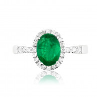 White Gold Ring With Oval Cut Emerald And Brilliant Cut Diamonds