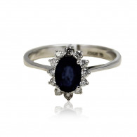 White Gold Ring With Oval Cut Sapphire And Brilliant Cut Diamonds